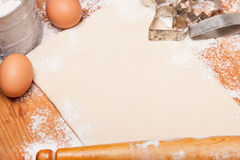 Pastry, rolling pin, eggs and figures for cookies Royalty Free Stock Photos