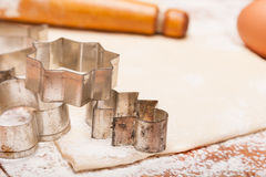 Pastry, rolling pin, eggs and figures for cookies Stock Photography