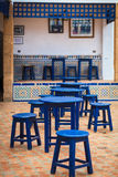 Pastry shop. Tables and chairs colored in blue Royalty Free Stock Image