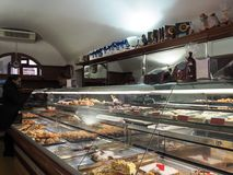 Pastry shop in Bevagna medieval town in Italy. Interior of Pastry shop in Bevagna medieval town. Umbria Region, central Italy. Shop that sells typical sweets of royalty free stock photography