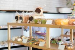 Pastry shop display at wooden shelve, cookies showcase stock images