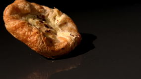 Pastry snack falling on black background stock video footage