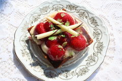 Pastry with strawberries. Delicious pastry with strawberries and decoration of white chocolate Stock Image