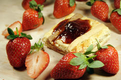 Pastry and strawberry Stock Images