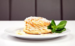 Pastry with sugar powder, almonds and mint Royalty Free Stock Photo