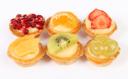 Pastry tartlets with fresh fruit isolated on white Stock Photography