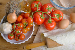 Pastry and tomato pizza ingredients Stock Image