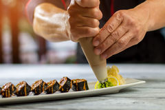 Pastry tool near sushi rolls. Stock Photography