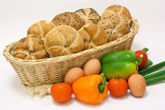 Pastry with vegetable. Basket with buns and different vegetable Royalty Free Stock Image