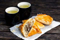 Pastry With Beef, Potato And Onion, Mugs Of  Green Tea