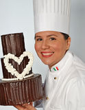 Pastry woman holding a  chocolate cake Royalty Free Stock Photo