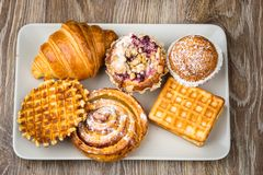 Pastry on wooden background Royalty Free Stock Photos