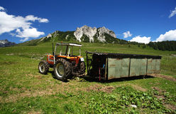 Pasture. Passo del Crocedomini (Bs), Lombardy,Italy,a tractor with portable tool to milk the cows in pasture Stock Image