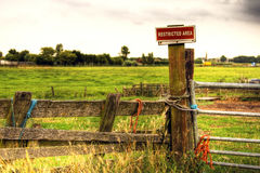 Pasture fence. With restricted area sign stock photo