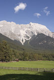 Pasture in front of mountains Royalty Free Stock Image