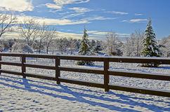 Pasture Land in the Snow. A pasture and fences in the first snow of the season stock photo