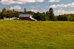 Pasture with red barn Stock Photos