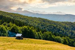 Pasture and shed on the hillside. Lovely summer landscape of Carpatian mountain Stock Photo