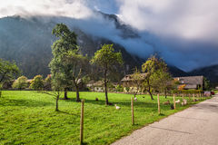 Pasture in a small village in the Alps Stock Image