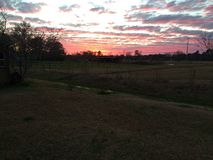 Pasture Sunset. Late evening sunset over a pasture taken with 5s iPhone Stock Photo