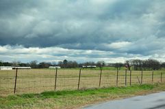 Pasture under Stormy Skies Stock Photography