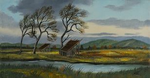 Pastureland with two small barns and a river royalty free stock photography
