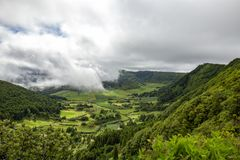 Beautiful view of Pastures. Pastures and green forest near Sete Cidades on Sao Miguel in the Azores stock images