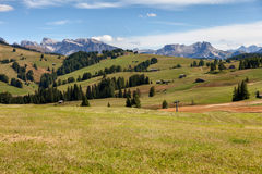 Pastures and mountain. Panoramic view of pastures on the background of the Dolomites Mountains Stock Photography