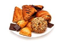 Pasty, плюшки и шоколад Стоковые Изображения RF