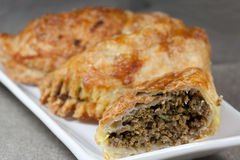 Free Pasty Filled With Minced Meat On A White Plate With Beige Background Stock Photo - 30215610