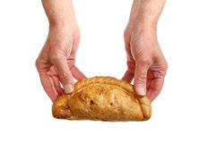 Pasty in hand Royalty Free Stock Image
