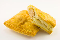 Pasty and Sausage Roll. Single golden pasty with single sausage roll on a white background Royalty Free Stock Image