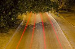 Pasy ruchu i czerwoni samochodowi światła Zdjęcie Royalty Free