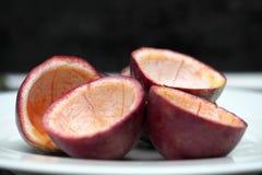 Pasyjnej owoc połówki cięcia pusty inside Fotografia Royalty Free