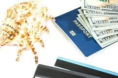 Paszport, dolary, skorupa, karty na bielu zdjęcia royalty free