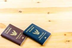 Paszport od Tajlandia na tle Fotografia Stock