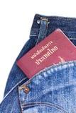 Paszport w kieszeni na białym tle Fotografia Stock
