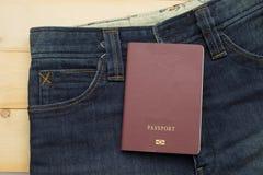 Paszportowy stawiający dalej raczej stary błękitny cajg Fotografia Royalty Free