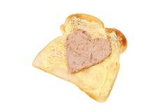 Patè a forma di del cuore su pane tostato fotografie stock libere da diritti