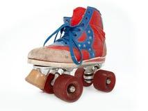 Patín de ruedas viejo del estilo de la vendimia Foto de archivo