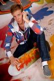 Patín del muchacho, pared de la pintada Imagen de archivo