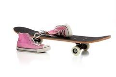 Patín y zapatillas de deporte rosadas Fotografía de archivo