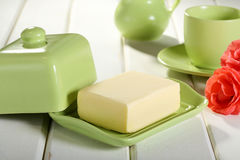Pat of Butter on green ceramic Royalty Free Stock Images