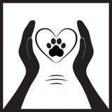 Pata animal do cão nos povos hand1 Imagem de Stock