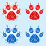 Pata del perro del Año Nuevo 2018 Imagen de archivo