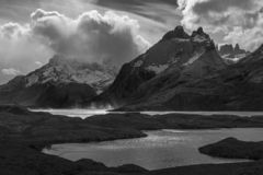 Patagonia in Black and White, Chile. Black and white photograph with strong contrasts of Nordenskjold and Pehoe Lake during a strong wind storm in Torres del stock photography