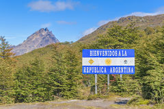 Patagonia Border Boundary Between Argentina and Chile. Forest with spanish signpost which say `welcome to argentina` located at the border boundary between stock image