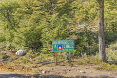 Patagonia Border Boundary Between Argentina and Chile. Forest with spanish signpost which say `welcome to chile` located at the border boundary between Argentina stock photography