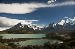 Patagonia Mountains and Lake, Chile. Snow capped mountains on a lake in Torres del Paine National Park, Chile, a popular destination for hikers and tourists Stock Images