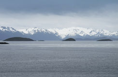 Patagonian cloudy landscape with mountains. Stock Photos